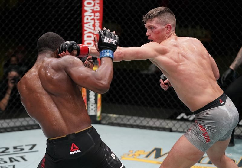 Stephen Thompson punches Geoff Neal in a welterweight fight