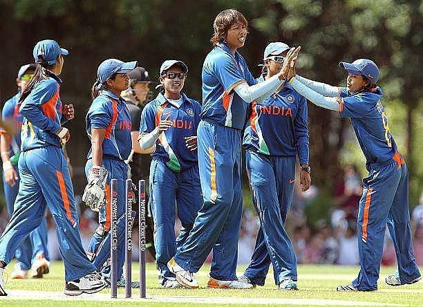 The Indian team celebrate after picking up a wicket.