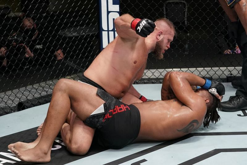 Former NFL star Greg Hardy was stopped by Marcin Tybura last night, suffering his first TKO loss in the UFC