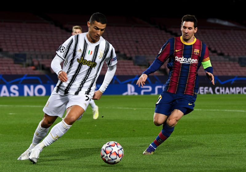 Cristiano Ronaldo of Juventus F.C. is put under pressure by Lionel Messi of Barcelona