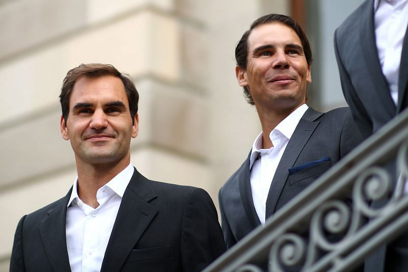 Roger Federer and Rafael Nadal (R)