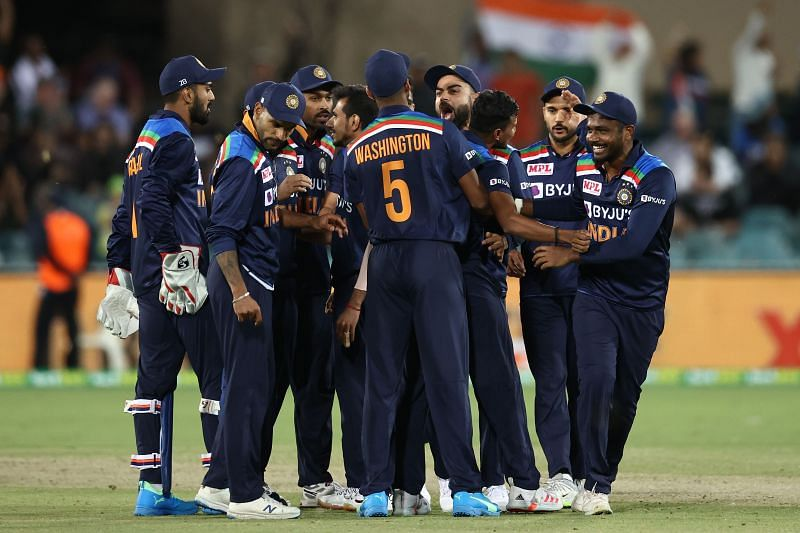 The Indian team celebrates after picking up a wicket.