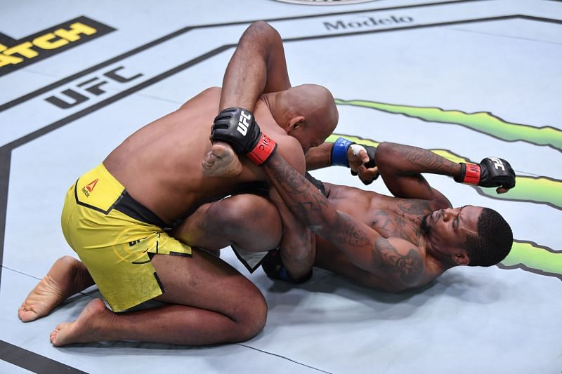 Kevin Holland elbows Jacare Souza of Brazil in their middleweight bout