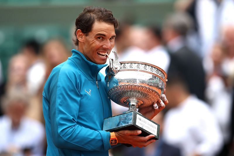 Rafael Nadal with his 2018 French Open trophy