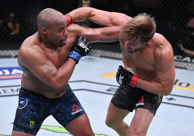Daniel Cormier (L) punches Stipe Miocic in their UFC heavyweight championship bout