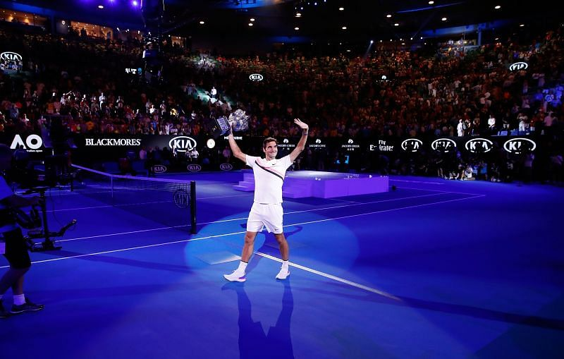 Roger Federer celebrates after winning the 2018 Australian Open