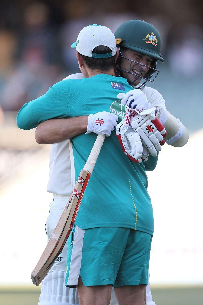 Joe Burns hugs Australian coach Justin Langer after Australia