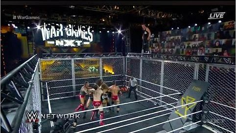 Pat McAfee on top of the cage