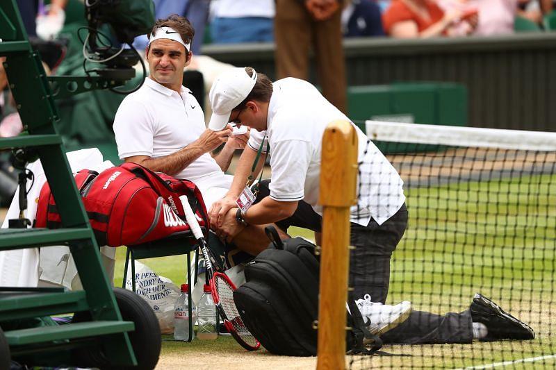 Roger Federer receives treatment at Wimbledon 2016