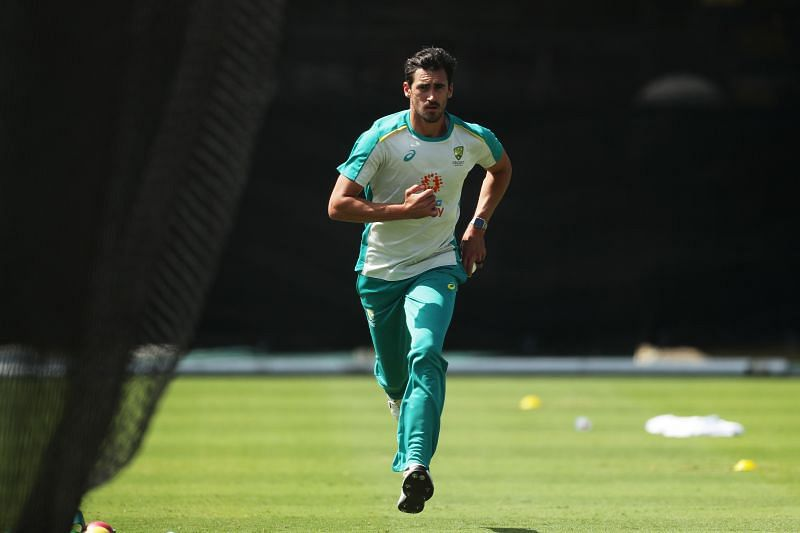 Mitchell Starc runs in to bowl during training.