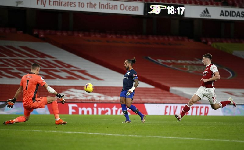 Theo Walcott helped Southampton take the lead against Arsenal