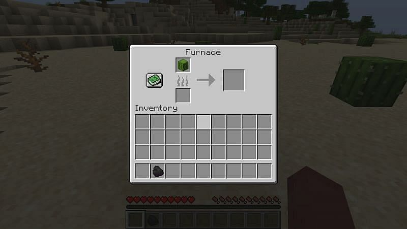 Place the cactus in the top available space in the furnace GUI
