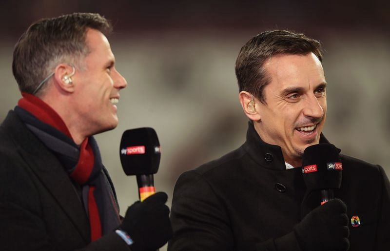 Jamie Carragher (L) and Gary Neville laugh prior to the Premier League match