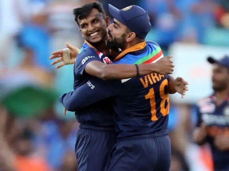 T Natarajan celebrates with Virat Kohli after picking up a wicket