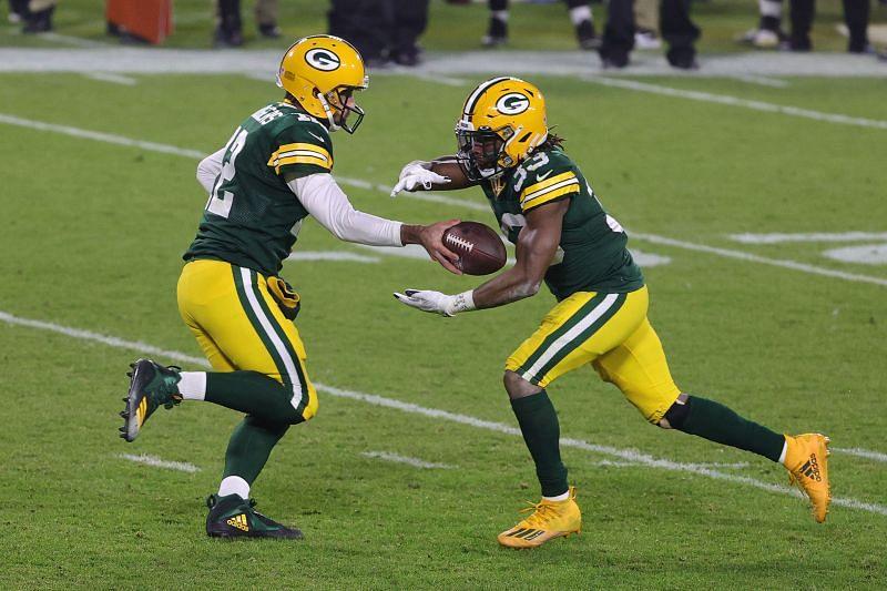 Aaron Rodgers hands the ball off to Aaron Jones