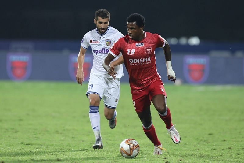 Diego Mauricio (in red) with the ball (Image courtesy: ISL)