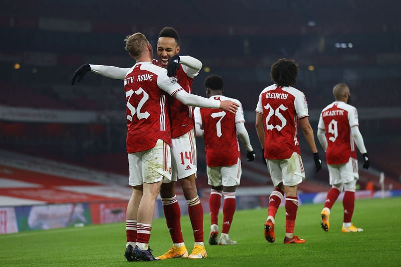 Arsenal scored twice in extra time to beat Newcastle United in the FA Cup on Saturday