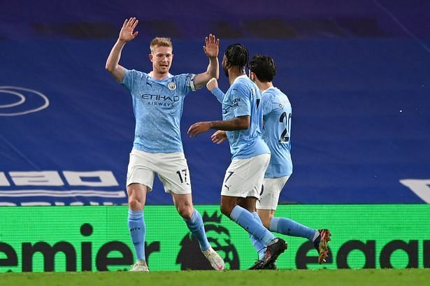 Kevin De Bruyne (left) celebrates after scoring off a rebound to put his side firmly in the lead.