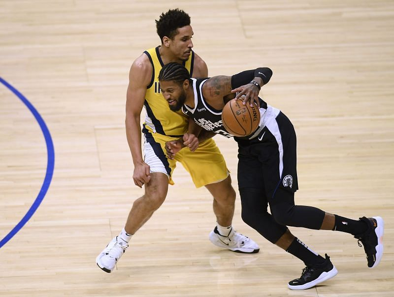 Paul George #3 of the LA Clippers keeps his dribble in front of Malcolm Brogdon #7 of the Indiana Pacers during the first half at Staples Center on January 17, 2021, in Los Angeles, California. (Photo by Harry How/Getty Images)