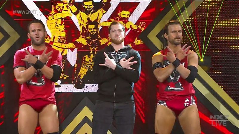 Roderick Strong(L) and Adam Cole(R) with Kyle O