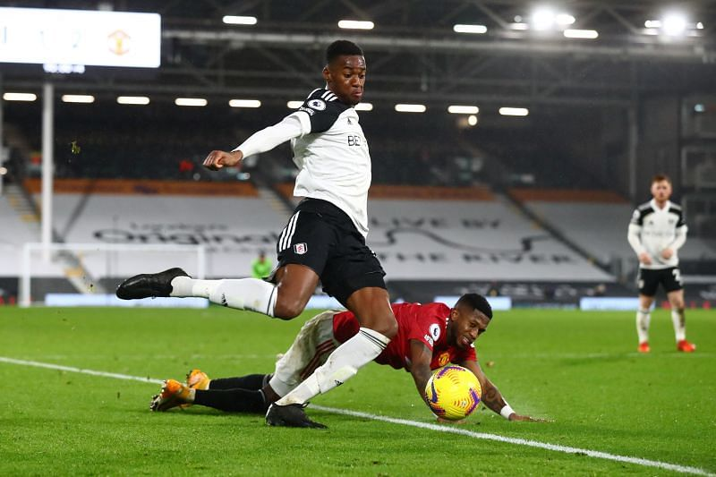 Tosin Adarabioyo of Fulham in action against Manchester United