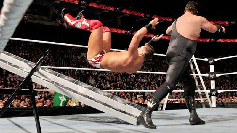 Jerry Lawler dropping The Miz on a ladder during their TLC Match for the WWE Championship