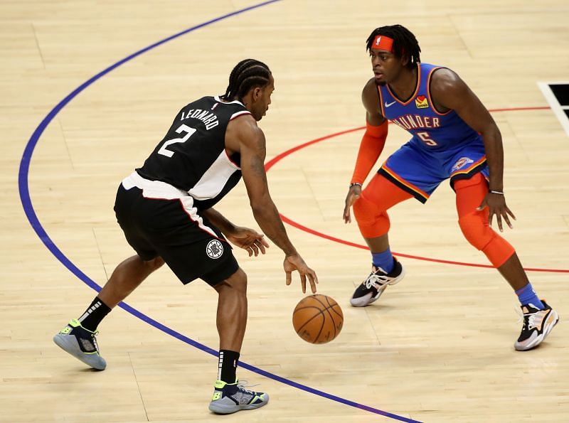 Kawhi Leonard of the Los Angeles Clippers manages the ball against Luguentz Dort of the Oklahoma City Thunder