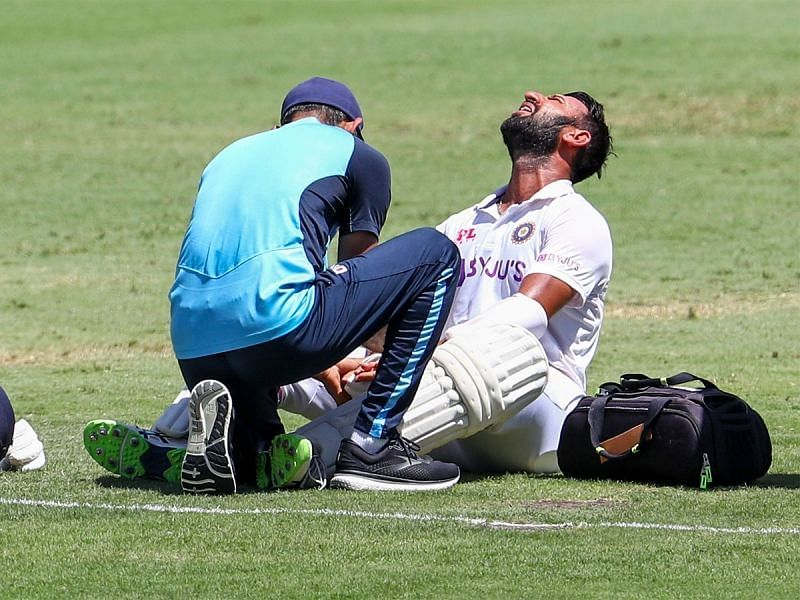Cheteshwar Pujara receives treatment after being hit. Pic: Twitter