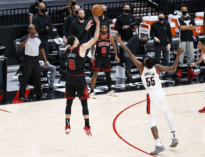 Zach LaVine of the Chicago Bulls shoots a three against Derrick Jones Jr. of the Portland Trail Blazers.