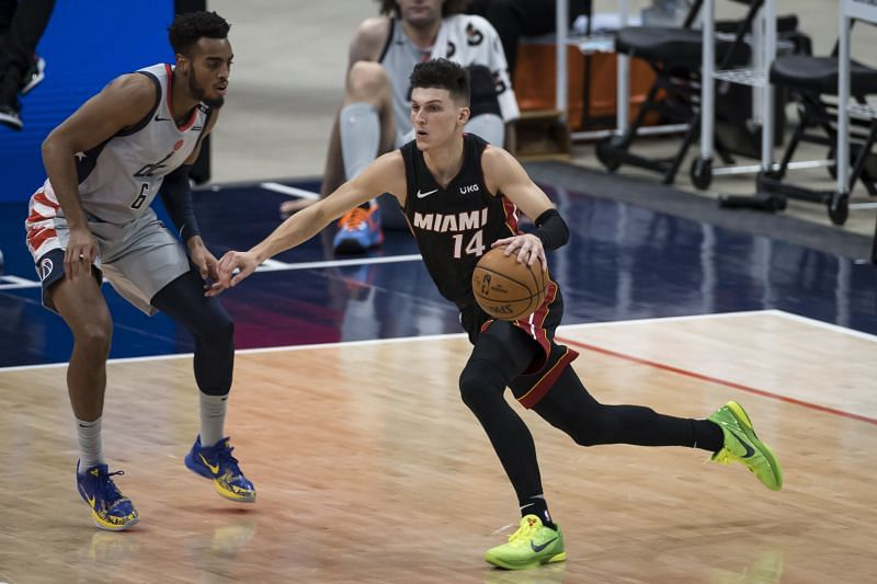 Tyler Herro #14 of the Miami Heat dribbles the ball as Troy Brown Jr. #6 of the Washington Wizards defends at Capital One Arena on January 9, 2021 (Photo by Scott Taetsch/Getty Images)