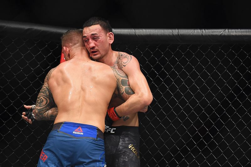 Dustin Poirier holding Max Holloway in a clinch