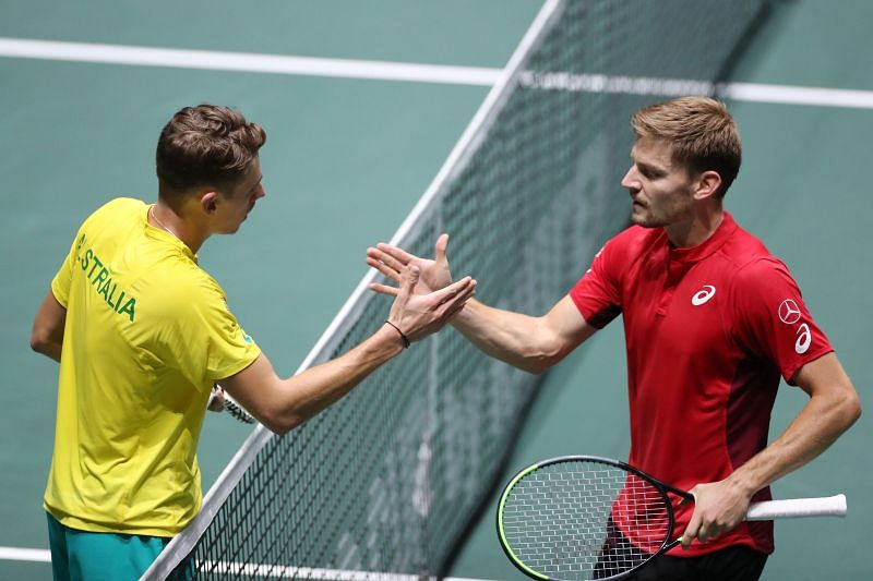 Alex de Minaur shakes hands with David Goffin at the ATP Cup