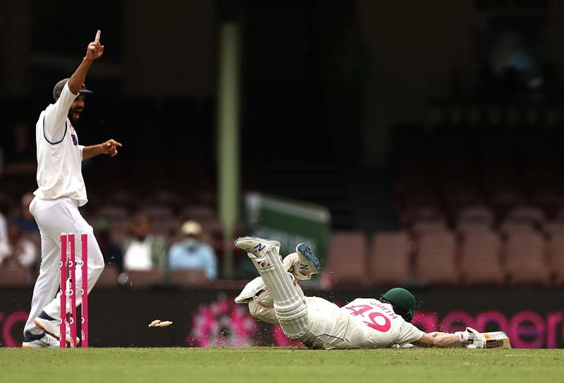 Ravindra Jadeja ran out Steve Smith with a direct hit from deep square leg.