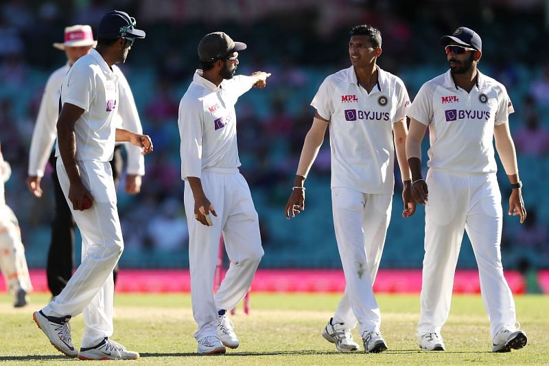 Navdeep Saini with teammates