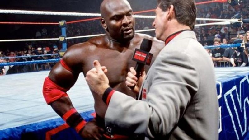 Ahmed Johnson and Vince McMahon in WWE