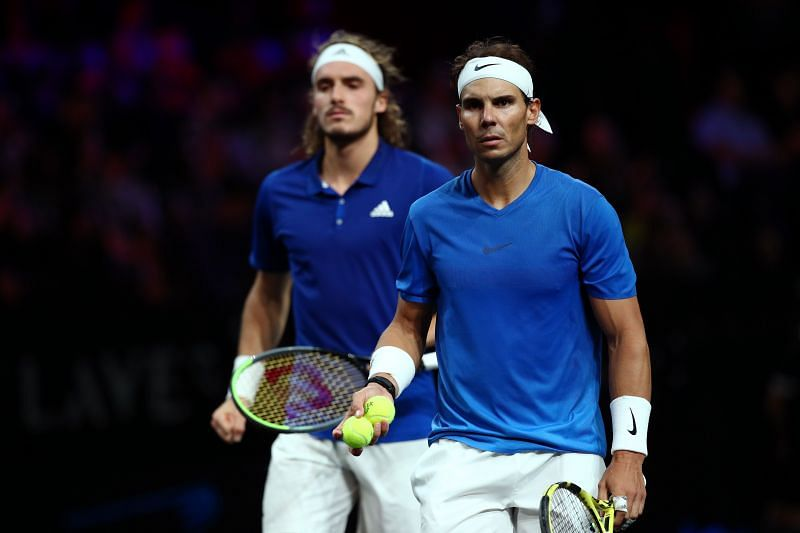 Stefanos Tsitsipas (L) and Rafael Nadal face each other at the ATP Cup