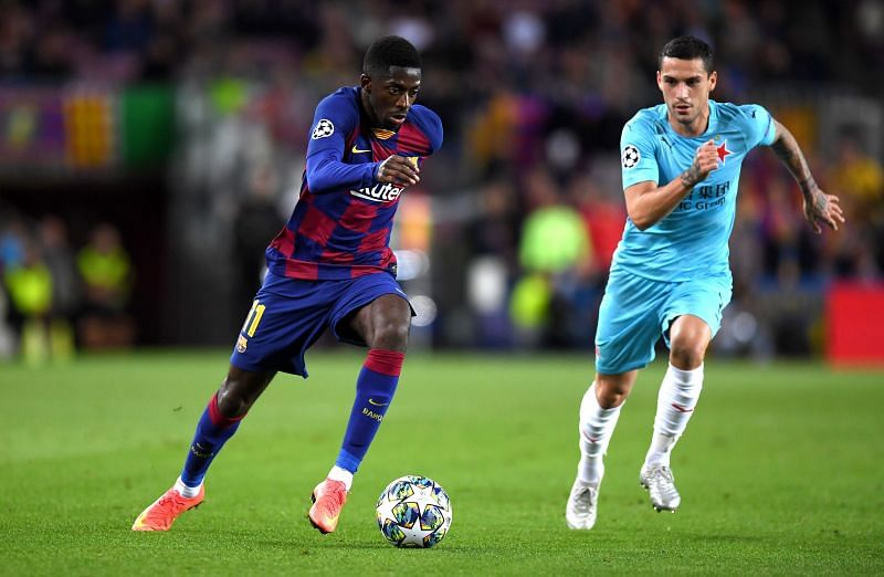 Ousmane Dembele (left) in action for Barcelona
