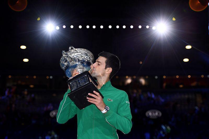 Novak Djokovic lifting the 2020 Australian Open title
