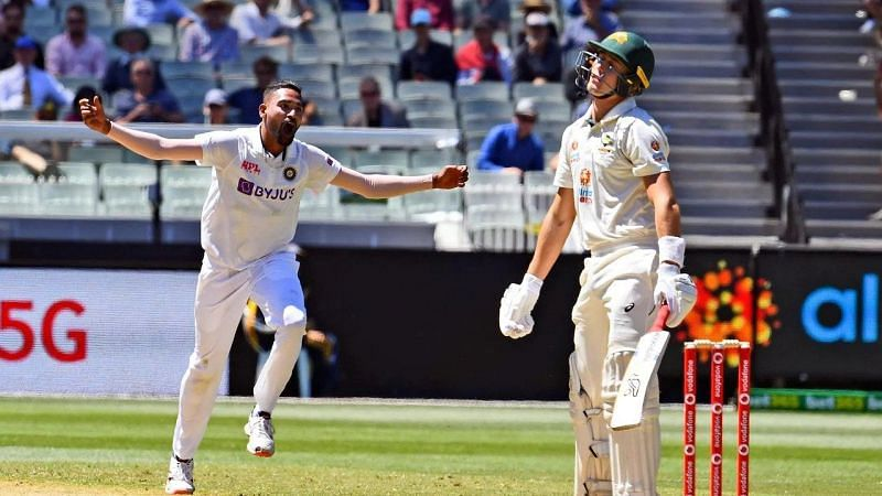 Mohammed Siraj celebrates after dismissing Marnus Labuschagne for his maiden Test wicket