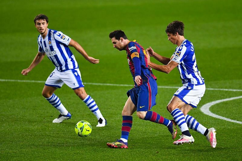 Lionel Messi and Le Normand battle for the ball during Barcelona