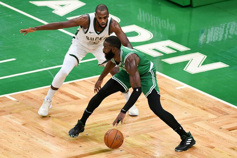Khris Middleton of the Milwaukee Bucks defends Jaylen Brown of the Boston Celtics
