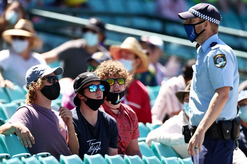 Police speaks to spectators at the SCG following a complaint from Mohammed Siraj