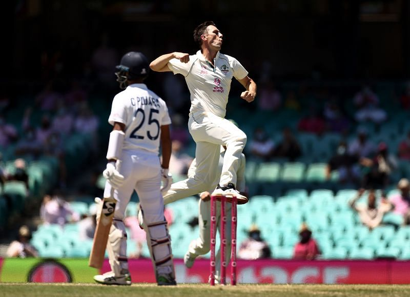 Pat Cummins celebrates after dismissing Cheteshwar Pujara at the SCG.