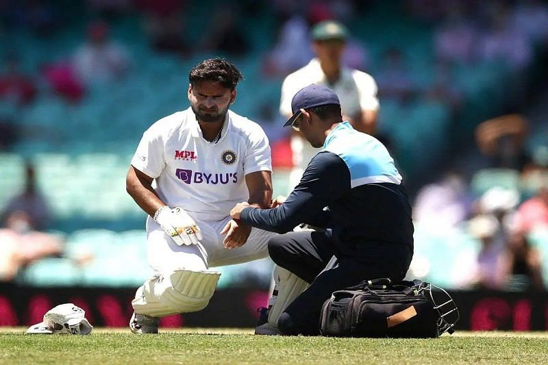 Rishabh Pant getting medical attention after being struck on the elbow