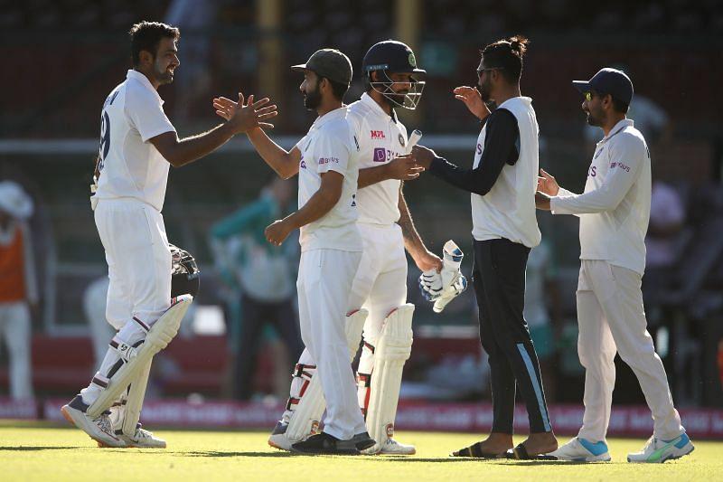 Ajinkya Rahane congratulates Hanuma Vihari and Ravichandran Ashwin after India drew the SCG Test.
