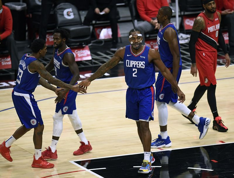 Kawhi Leonard of the LA Clippers celebrates and his basket with Lou Williams and Patrick Beverley during a 128-105 Clippers win at Staples Center on December 30, 2020
