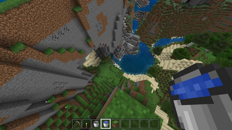 using a water bucket to create a waterfall for safe travel in Minecraft