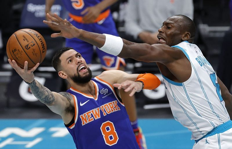 Austin Rivers of the New York Knicks attempts a layup against Bismack Biyombo.