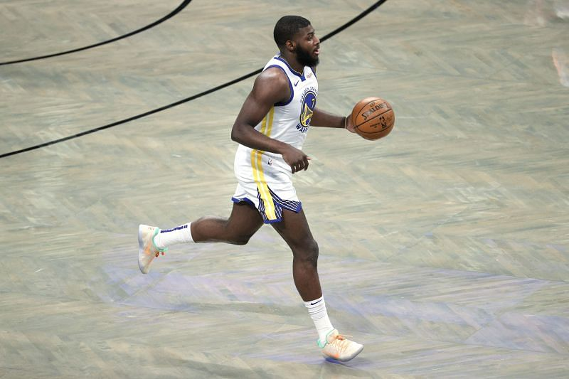 Eric Paschall #7 of the Golden State Warriors dribbles during the first half against the Brooklyn Nets.