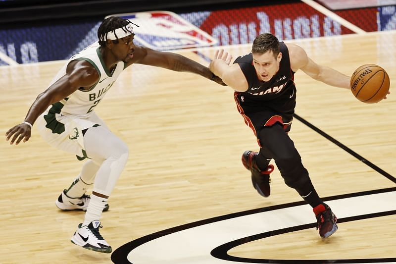 Goran Dragic #7 of the Miami Heat drives to the basket past Jrue Holiday #21 of the Milwaukee Bucks during the second quarter at American Airlines Arena on December 29, 2020 (Photo by Michael Reaves/Getty Images)